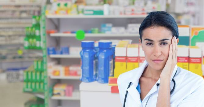 Portrait of female doctor in pharmacy store #417081