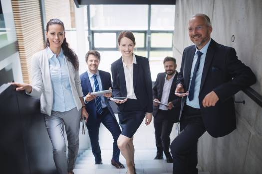 Group of confident businesspeople in office Free Photo