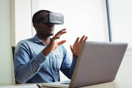 Business executive using virtual reality headset #417091
