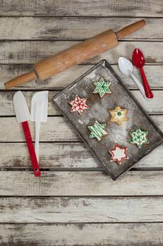 Spatula, spoon, rolling pin and tray with baked Christmas cookies #417133