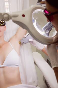 Female patient receiving laser hair removal treatment #417144