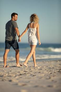 Couple walking together hand in hand on the beach #417169