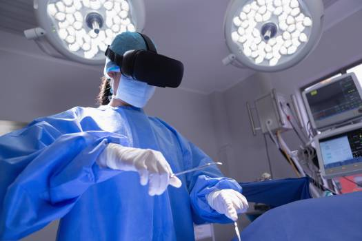 Female surgeon using virtual reality headset while practicing surgery in operation room at hospital #417174