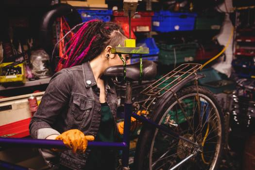 Mechanic repairing a bicycle #417191