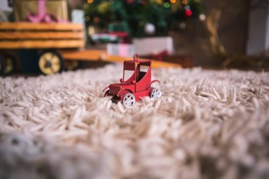 Toy car on fur carpet #417207