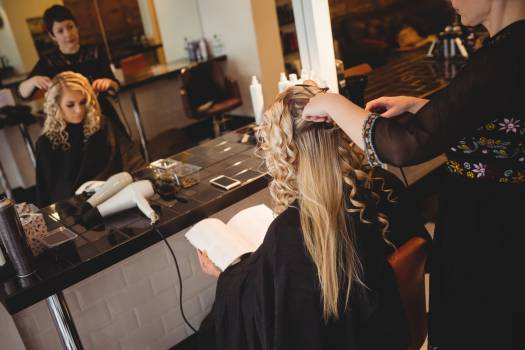 Female hairdresser styling clients hair #417315