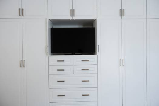 Empty wardrobe with television in living room #417343