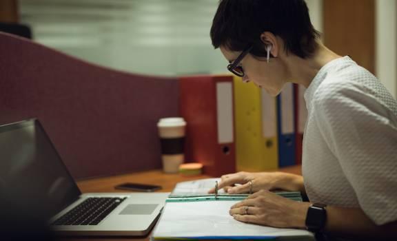 Businesswoman working at her desk #417436