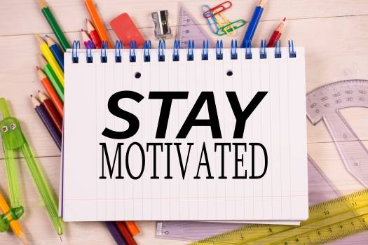 Stay motivated message on a notebook #417542