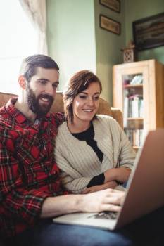 Couple using laptop in living room #417637
