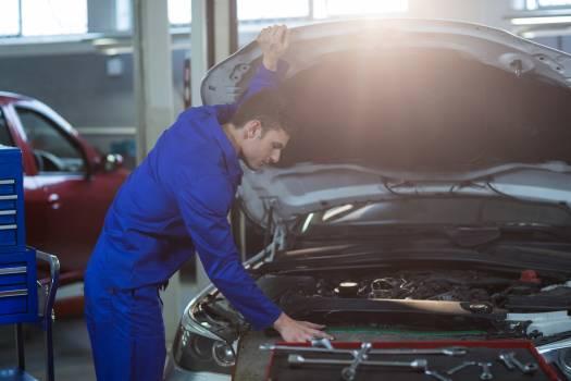Mechanic servicing a car engine #417702