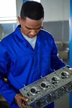Mechanic examining a car parts #417782