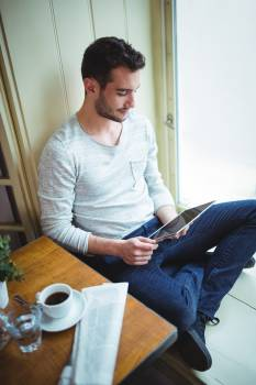 Man sitting in café and using digital tablet #417799