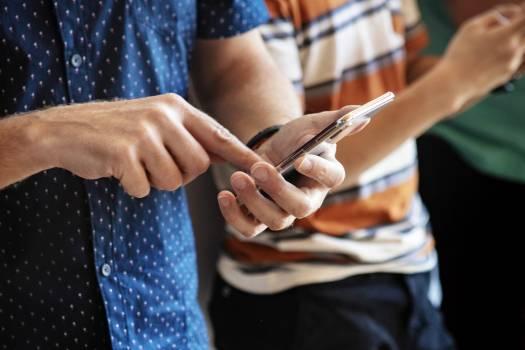 Closeup of people using their phones #417877