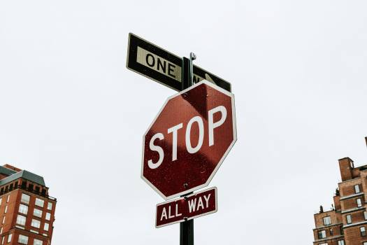Red stop sign in downtown #417883