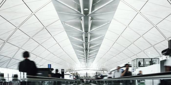 People on a moving walkway in a passenger terminal at the airport #417917