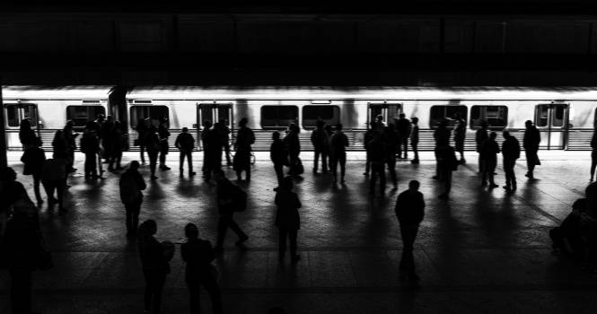 People waiting for a train on a platform #417939