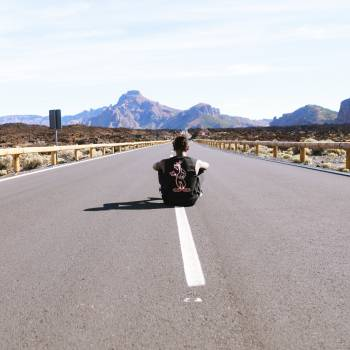 Man sitting in empty road Free Photo #418284