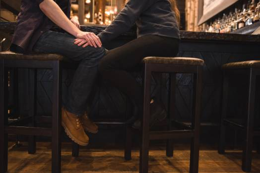 Romantic couple sitting on stool at bar counter #418291