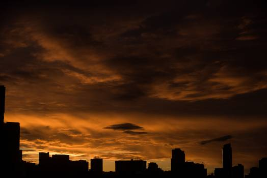 Silhouette cityscape during sunset Free Photo