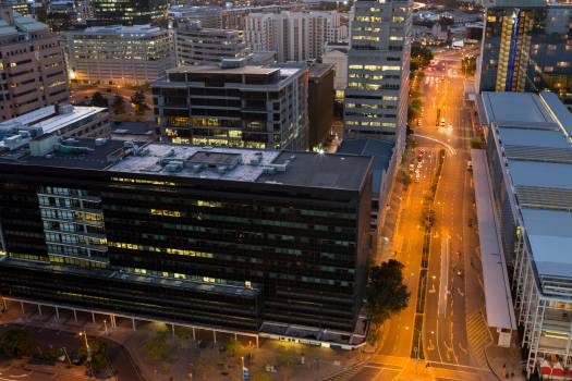 Aerial view of streets and office building in business district Free Photo