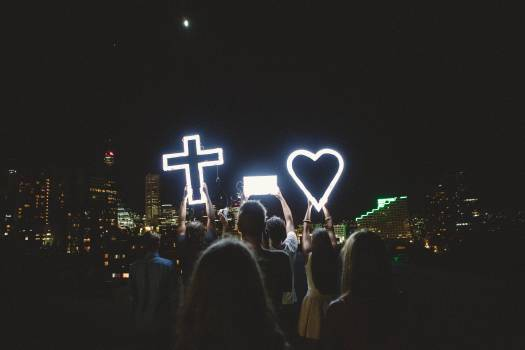 Man and Lady Raising Cross Heart Led Light Photo during Night Time #418469