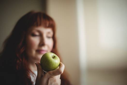 Businesswoman holding an apple #418482