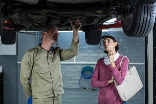 Mechanic showing customer the problem with car #418641