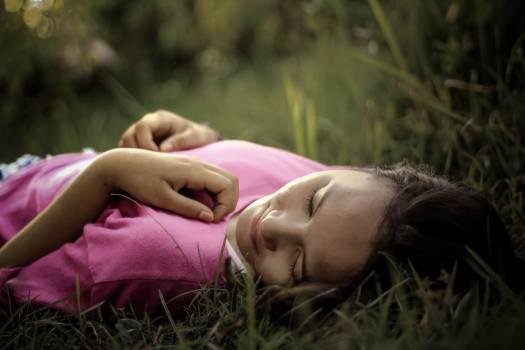 Woman Lying on Green Grass #41867