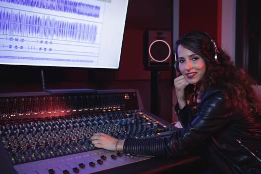 Female audio engineer using sound mixer #418961