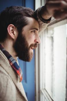 Man looking through window Free Photo