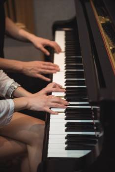 Couple playing a piano #419161