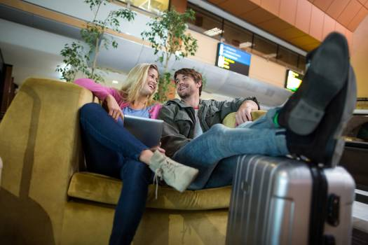 Smiling couple interacting with each other in waiting area #419167