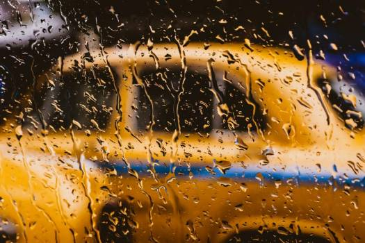 A Yellow Taxi Behind A Rain-Spattered Window #419419
