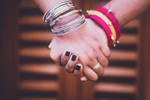 Two People Holding Bangle-Adorned Hands #419423