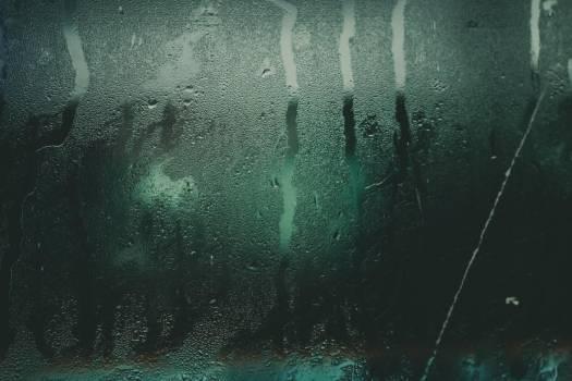 Light Through A Wet Window Pane At Night #419428