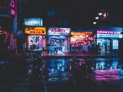 Neon Shop Lights Reflect On Rain-Wet Streets In India #419429