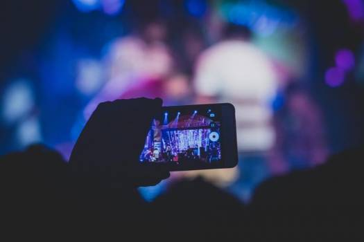 A Concert Seen Through An Audience Member's Mobile Phone #419436