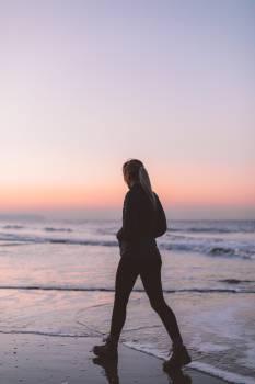 Woman Walking on Beach Free Photo #419621