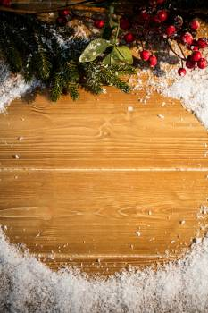 Christmas decorations on wooden plank Free Photo