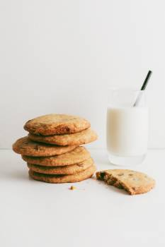 A Stack Of Cookies And A Glass Of Milk #421300