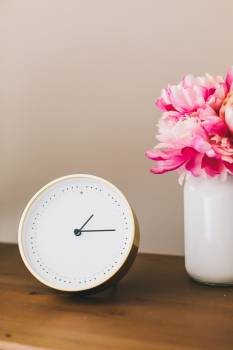 Clock And Flowers On Side Table #421714