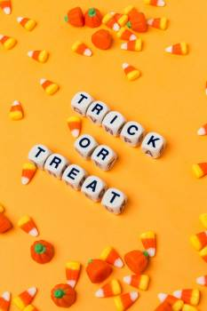 Trick Or Treat On An Orange Background With Candy Corn #421809