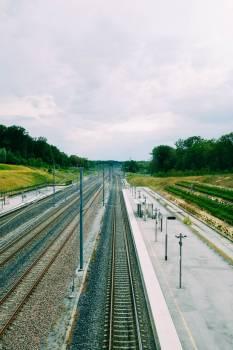 Bare Train Tracks Alongside An Empty Platform #421924