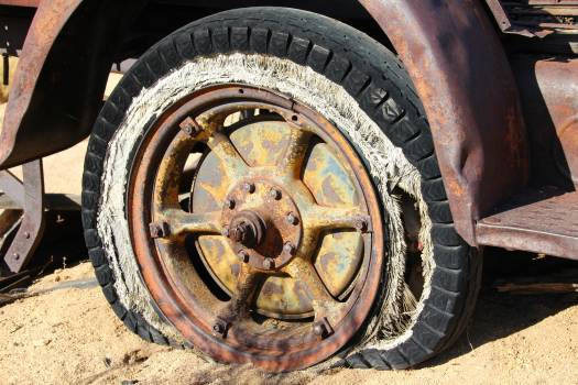 Brown Spoke Car Wheel in Brown Sand during Daytime #42235