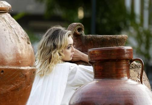 Selective Focus Photo of Woman Leaning on Huge Jar #422410