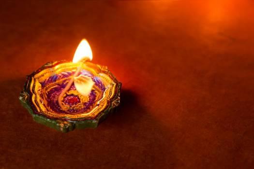 A Flower Shaped Diya Lamp Glows Softly #422481