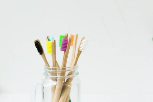 Colorful Toothbrushes In Jar #422622