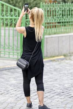 Woman Wearing Black Sleeveless Dress Holding Smartphone #423070