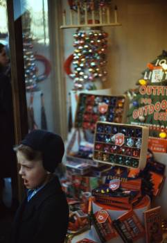 Boy beside Store Window Display of Christmas Ornaments. Original from Library of Congress.  Free Photo